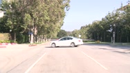 Stock Video Footage of A car travels along a street in Century City, Los Angeles as seen through the