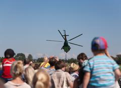 helicopter in the sky air show - stock photo