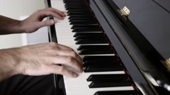Man playing jazz on the piano inside his home Stock Footage