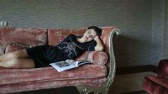 Beautiful woman sleeping on sofa Stock Footage