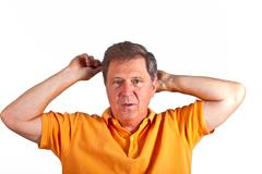 Stock Photo of attractive man combing his hair