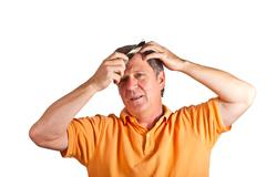attractive man combing his hair - stock photo