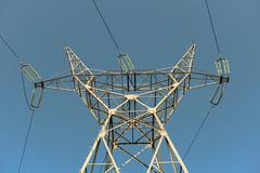 Large transmission towers at sunset Stock Photos