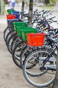 Parked rental bicycles with colorful baskets in La Digue, Seychelles Stock Photos