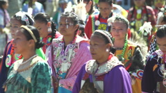 Grand entry of mostly women during pow wow Stock Footage