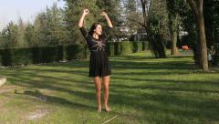 lively, cheerful, happy, carefree woman smiling and turning around on the grass. - stock footage