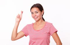 Stock Photo of Cheerful latin girl with luck fingers
