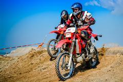 motocross riders - stock photo