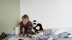 A toddler jumping on his bed in his bedroom Stock Footage