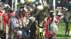 Pow wow dancers dance in the arena Stock Footage