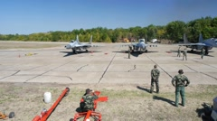 Aerial view of military airplanes exercises Stock Footage