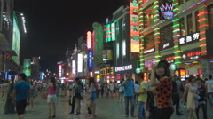 Busy commercial district Guangzhou night neon sign shop ad tourist people enjoy  Stock Footage