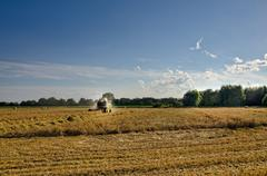 Tractors and harvesting Stock Photos