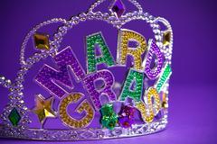 Mardi Gras crown on a purple background - stock photo