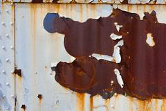 Rusty, peeling piece of steel for a background or grunge effect - stock photo