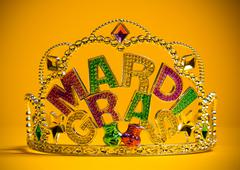 Jeweled Mardi Gras crown on a yellow background Stock Photos