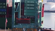 Stock Video Footage of Loading Dock Crane Raises Red Contianer