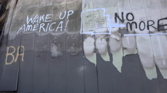 Graffiti messages left on the burned out rubble of Ferguson Missouri urge Stock Footage