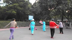 Shenzhen, China: citizens in jump square dance Stock Footage