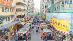 4k timelapse video of street vendors and people shopping in market in Hong Kong Stock Footage