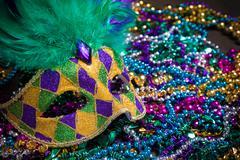 Mardi Gras Masks on dark Background Stock Photos