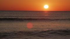 Sunrise glow on waves Stock Footage
