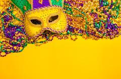 Mardi Gras Mask on yellow Background - stock photo