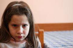 young girl with tear that has just finished crying - stock photo