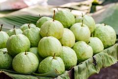 Green guava on banana leave - stock photo