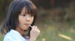 Happy girl eating lollipop Stock Footage