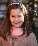 European child happy with a wool sweater Stock Photos