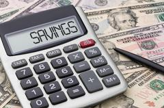 Calculator with money - Savings Stock Photos