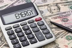 Calculator with money - Energy - stock photo