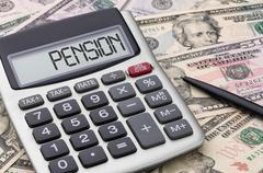 Calculator with money - Pension Stock Photos