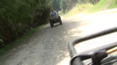 Group of people driving four wheeler ATV Stock Footage