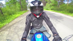 Motorcycle rider on a road, view from swivel helmet mount Stock Footage