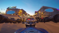 Riding a motorcycle in a city Stock Footage