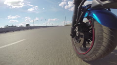 Riding a motorcycle, view on front wheel - stock footage