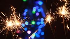 sparkler and bokeh lights background - stock footage