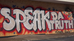 Graffiti on a boarded up and looted market urges people to speak the truth. Stock Footage