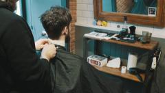 Barber starts his work with customer Stock Footage