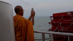 Buddhist Monk Take a Picture of Sea Using Smartphone Stock Footage