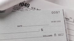 Person writing check to pay income tax Stock Footage