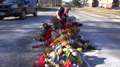 A makeshift memorial for Michael Brown, shooting victim, in Ferguson Missouri. Stock Footage
