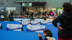 Dog exhibition competition event panning over room Stock Footage
