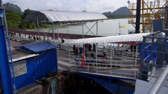 Passengers Disembarking from Ship at Pier Stock Footage