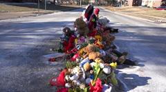 A makeshift memorial for Michael Brown, shooting victim, in Ferguson Missouri. - stock footage