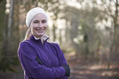 Portrait Of Woman On Winter Run Through Woodland Stock Photos