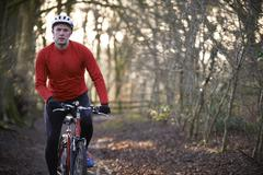 Man Riding Mountain Bike Through Woodlands Stock Photos