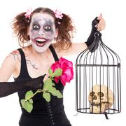 insane girl with rose and skull - stock photo